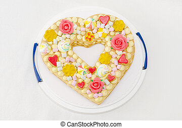 birthday cake like heart with different candies, view from top