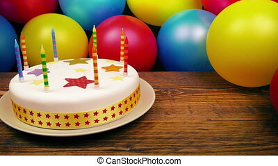 Birthday Cake On Table With Balloons - Moving slowly past a...
