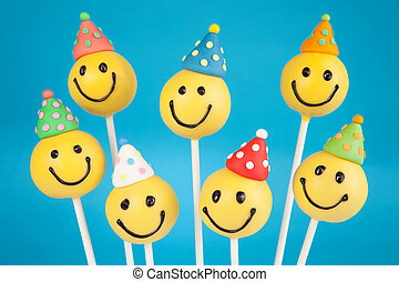 Birthday cake pops - Smiley face cake pops. Round-shaped...