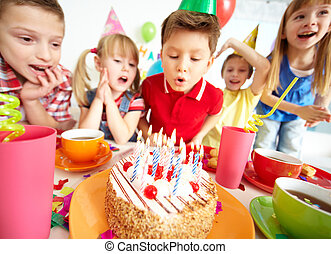 Birthday cake - Group of adorable kids looking at birthday...