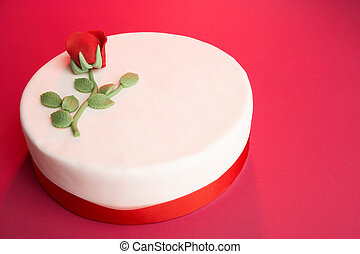 birthday cake - white tarte with a red rose on it
