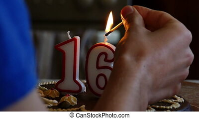 Birthday cake winth candles - Hand lighting a Sixteenth...