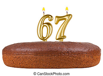 birthday cake with candles number 67 isolated