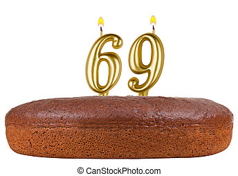 birthday cake with candles number 69 isolated