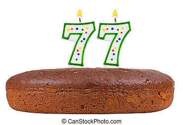 birthday cake with candles number seventy seven
