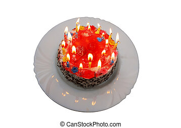 birthday cake with lighted candles on plate