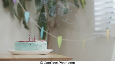 Birthday cake with smoke from candles that were just blown ...