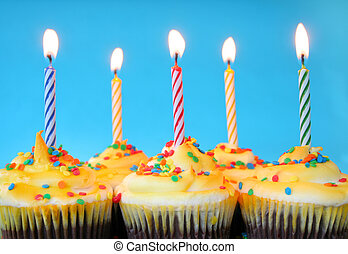 Birthday Candles - A group of cupcakes with burning candles...