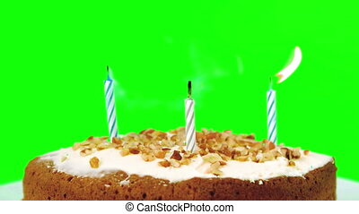 Birthday candles being blown out on green screen