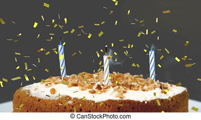 Birthday candles on a cake and confetti