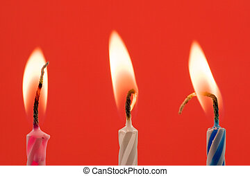 birthday candles on a red background
