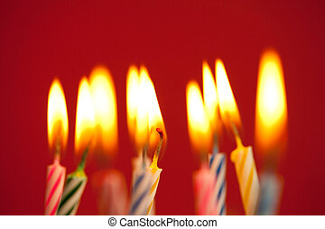 Birthday candles on red background  - Birthday candles