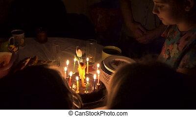 birthday celebration by candlelight in dark room