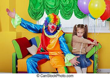 Birthday celebration with clown.