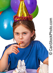 Birthday child celebrate party and eating cake on plate.