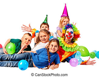 Birthday child clown playing with children.