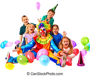 Birthday child clown playing with children. Kid cakes celebratory.