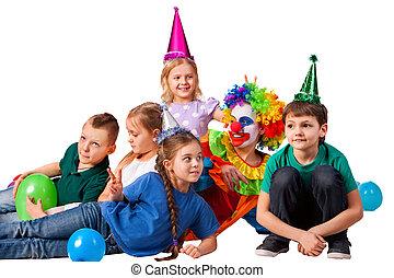 Birthday child clown playing with children. Kid cakes celebratory.