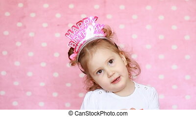 Birthday. Child girl child smiles, has fun and sings a song congratulations