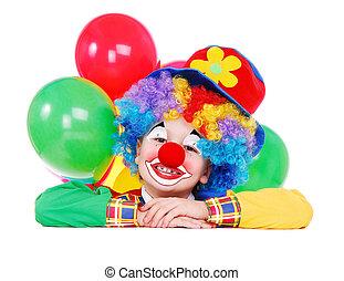 birthday clown holding the blank board