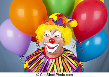 Birthday Clown - Clown surrounded by colorful helium...