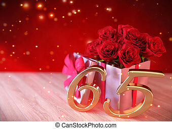 birthday concept with red roses in gift on wooden desk. sixtyfifth. 65th. 3D render