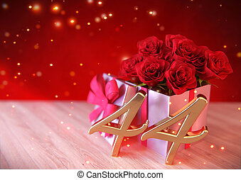 birthday concept with red roses in the gift on wooden desk. forty-fourth . 44th. 3D render