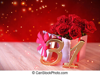 birthday concept with red roses in the gift on wooden desk....