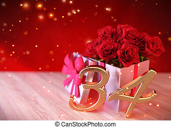 birthday concept with red roses in the gift on wooden desk. thirty-fourth . 34th. 3D render