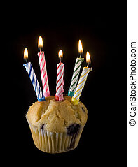 birthday cupcake - a small cupcake with 5 lit candles on top
