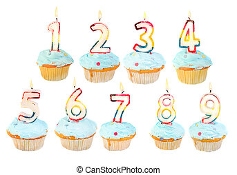 A set of birthday cupcakes with lit candles with numbers 1 to 9