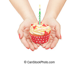 birthday cupcake in hand isolated on white background