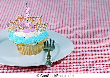 Birthday cupcake on a plate