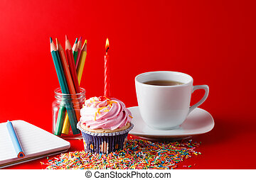 Kid birthday small gift. Cupcake with candle on brigth red background