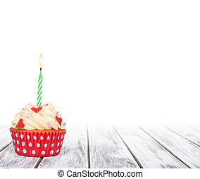 birthday cupcake on white wooden table