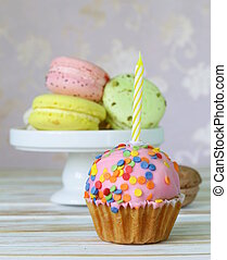 birthday cupcake with a candle and holiday desserts