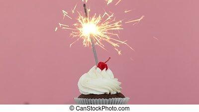 Birthday cupcake with a sparkler pink background - Birthday...
