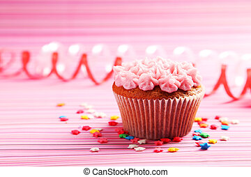 Birthday cupcake with butter cream on colorful background