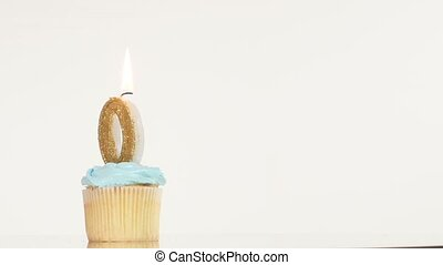 Birthday cupcake with candle number zero.