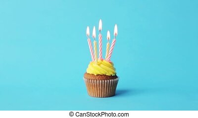 birthday cupcake with five burning candles