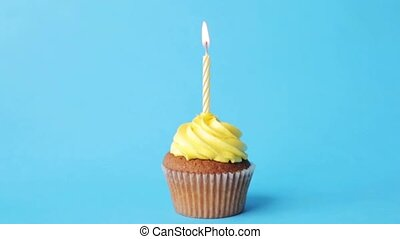birthday cupcake with one burning candle