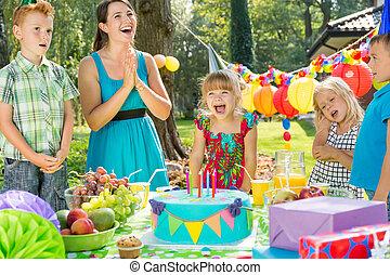 Birthday girl and cake