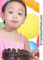 birthday girl holding cake