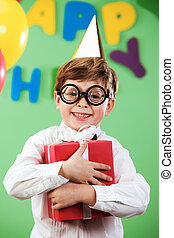 Birthday mood - Portrait of happy lad in funny eyeglasses on...