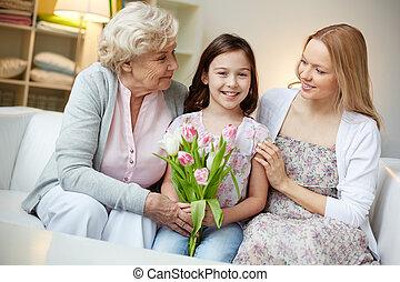 Birthday of girl - Portrait of happy little girl holding...