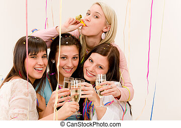 Birthday party celebration - four woman with confetti have fun with champagne
