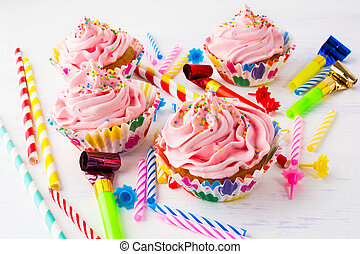 Birthday party concept with pink cupcakes