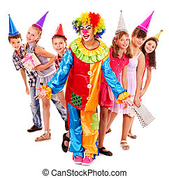 Birthday party group of teen with clown. - Birthday party...