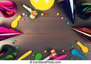 birthday party items and accessories on gray wooden background with copy space. top view