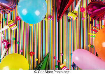 birthday party items on striped background with copy space. top view